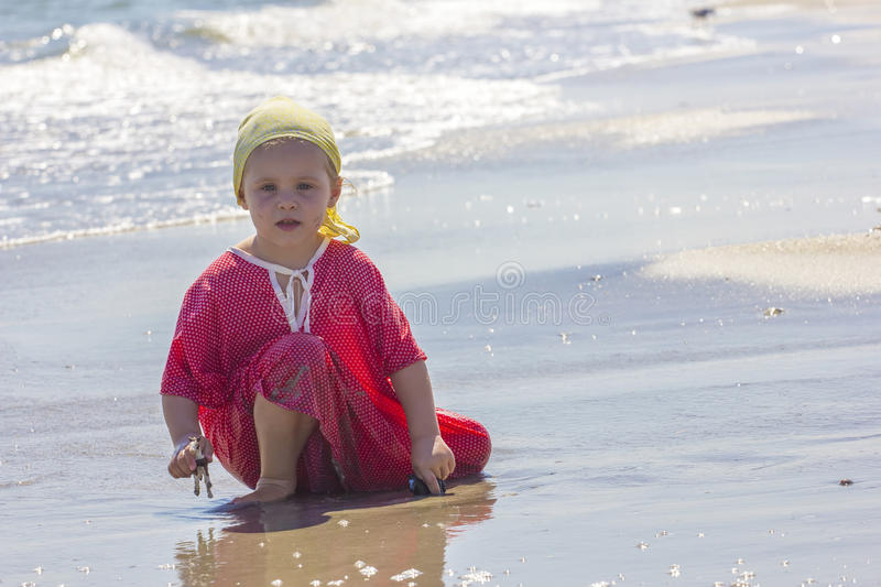 Child at the sea side royalty free stock photography