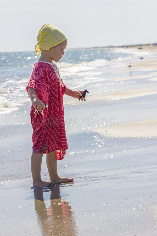 Child at the sea side royalty free stock photo