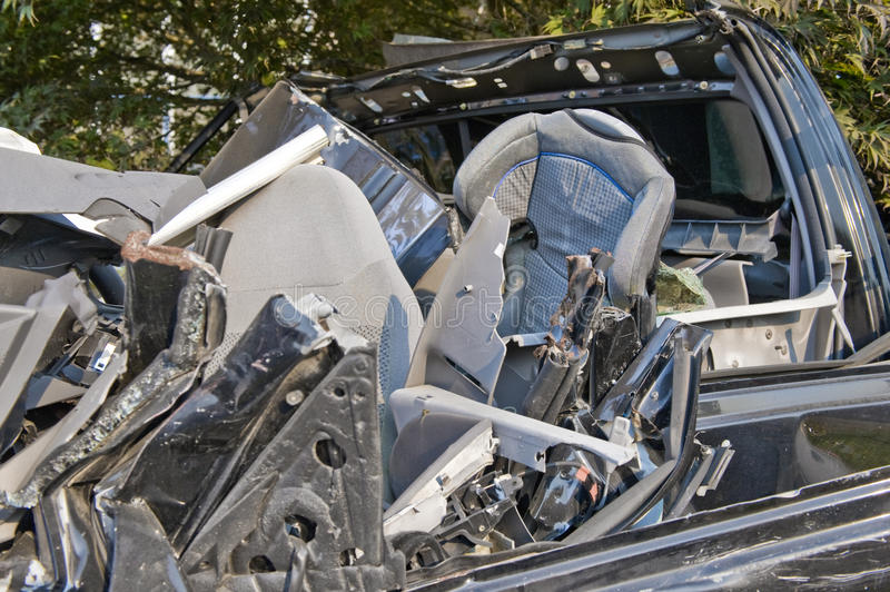 Child seat in car wreck royalty free stock photos