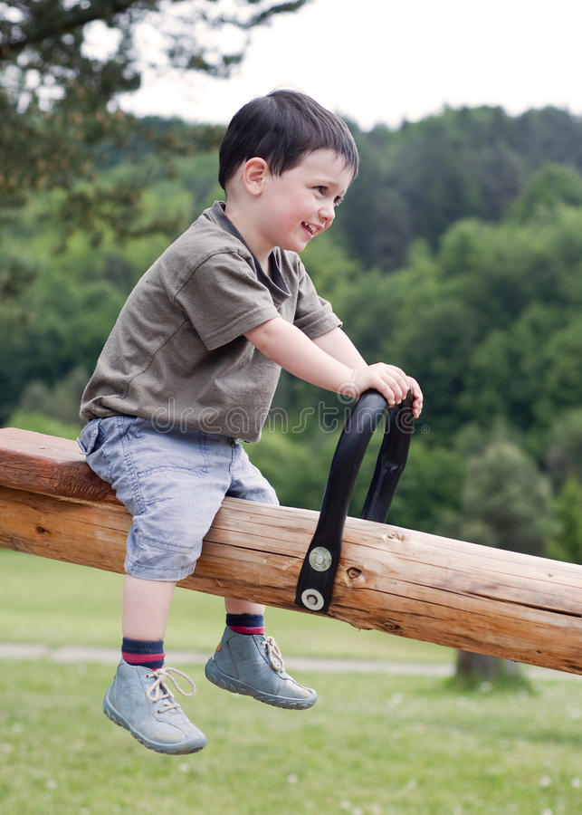 Download Child on seesaw stock image. Image of children, wood - 22484053