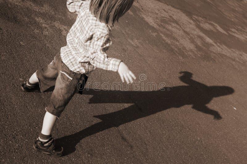 Child shadow silhouette stock photos