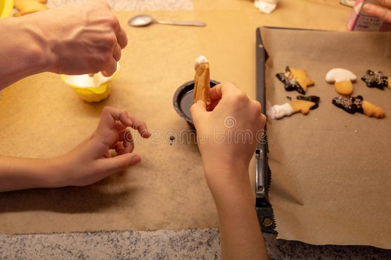 Child shaping and cutting baking cookies for christmas royalty free stock images