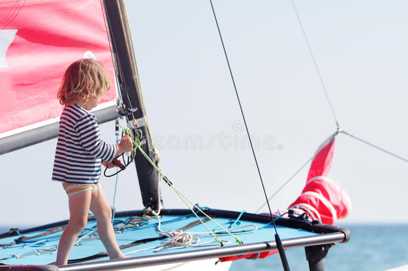 Child On Ship On Sea Background Stock Images
