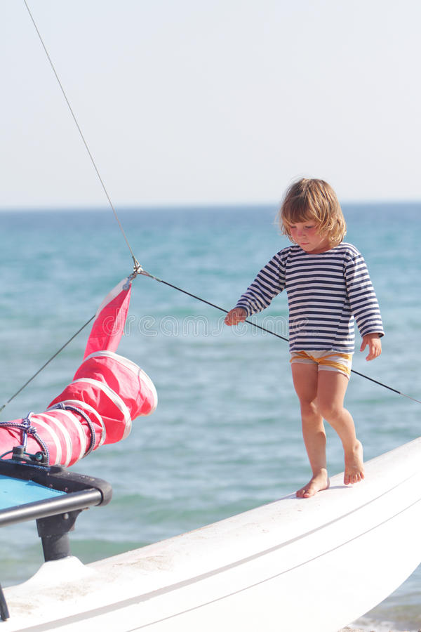 Download Child On Ship On Sea Background Stock Photo - Image: 26276492