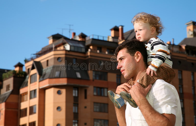 Child on the shoulders royalty free stock photography