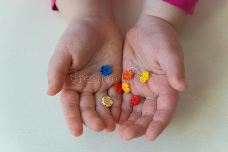 Child showing the little plastic toys in the hands stock photos