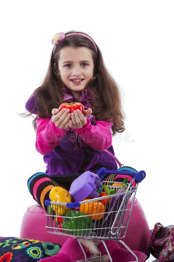Child showing vegetables royalty free stock photo
