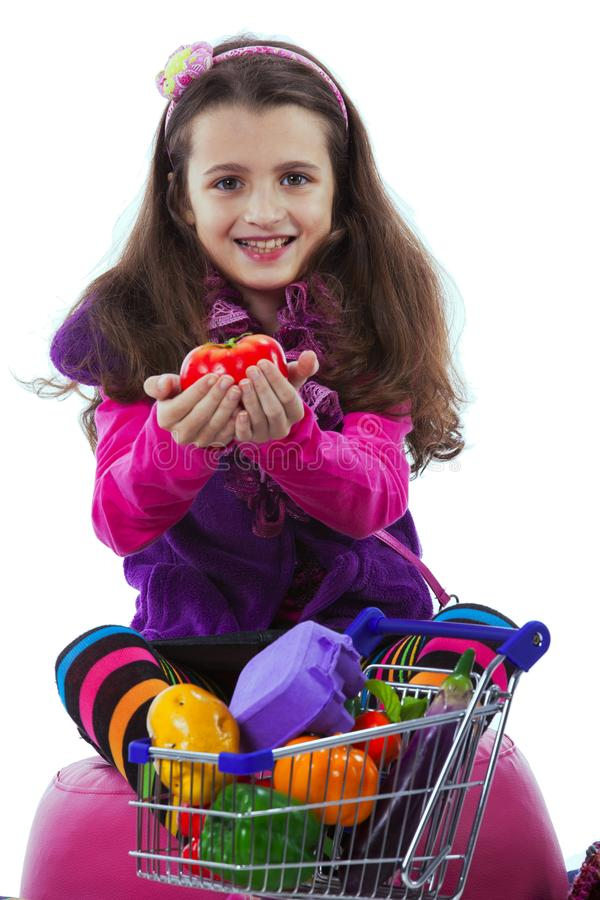 Child showing vegetables stock photos