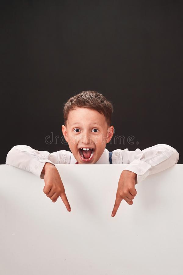 The child shows the free space. white and black space for text stock image