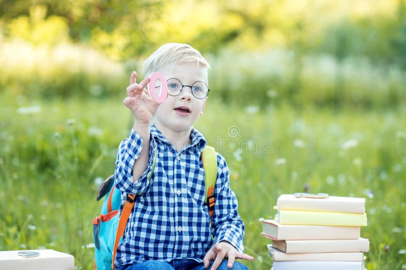 The child shows the number zero. Back to school. The concept of learning, school, mind, lifestyle and success stock photography