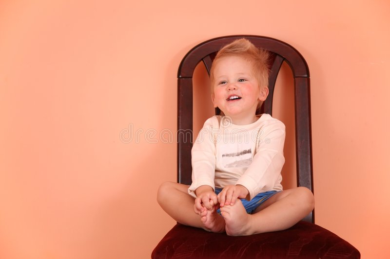 Child sit on chair in pink room royalty free stock photo