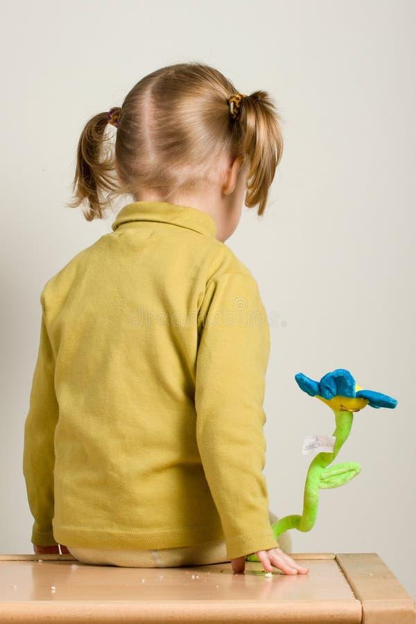 Child sitting stock image