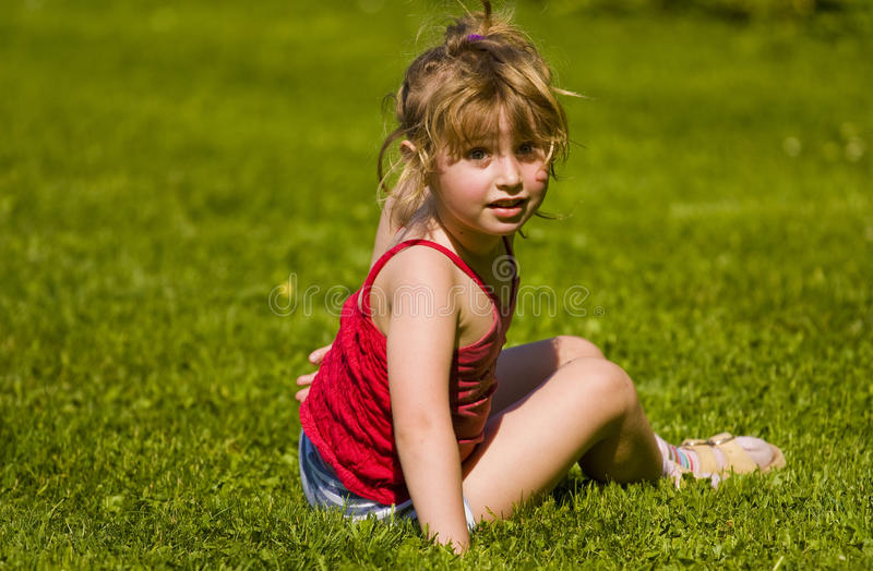 Child sitting stock images
