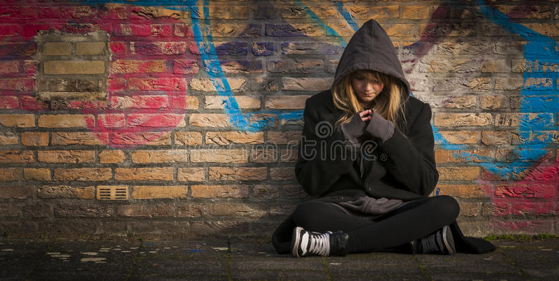 Child sitting alone and thinking stock images