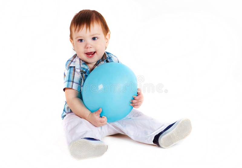 Download Child Sitting With Blue Baloon Stock Image - Image: 13858785