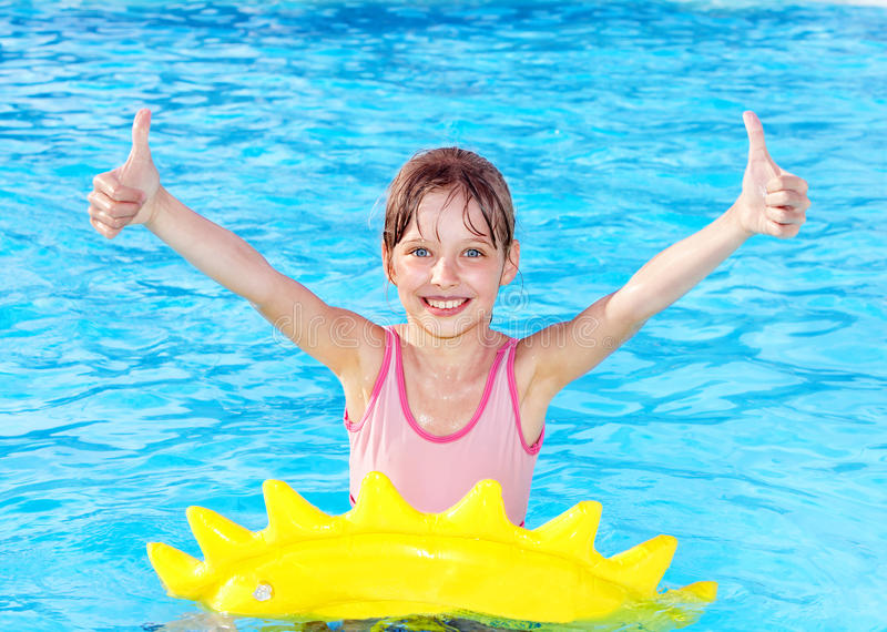 Download Child Sitting On Inflatable Ring Thumb Up. Stock Photography - Image: 18795232