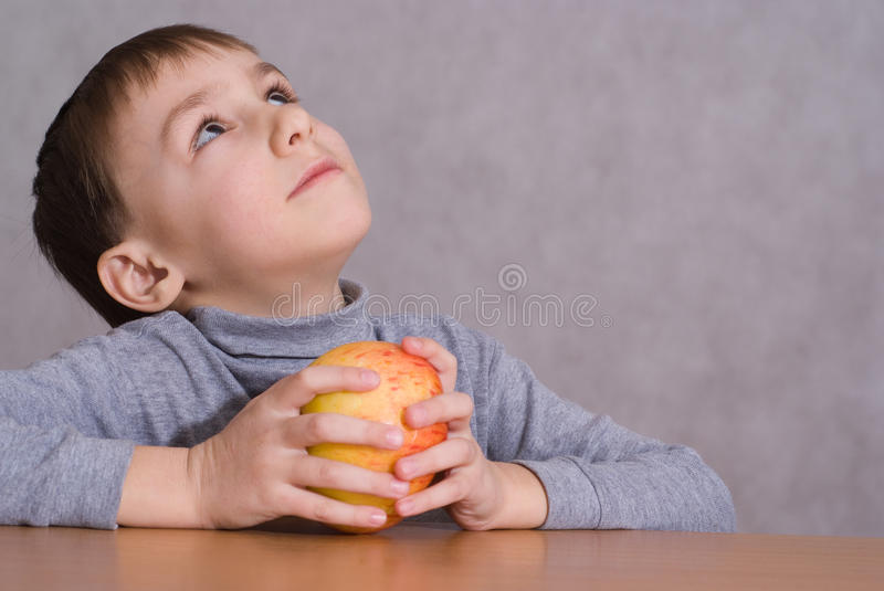 Download Child Sitting Next To An Apple And Dreams Stock Photo - Image of dreams, selective: 13032514