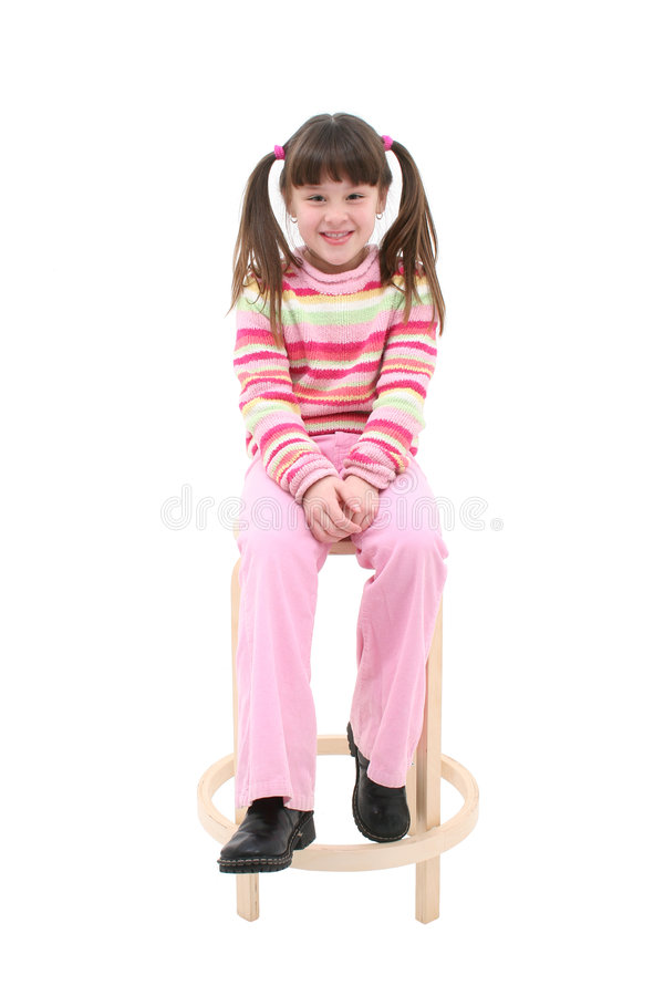 Free Child Sitting On A Wooden Stool Royalty Free Stock Photo - 64455