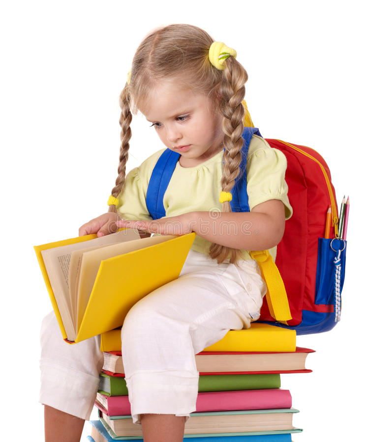 Child sitting on pile of books. royalty free stock image