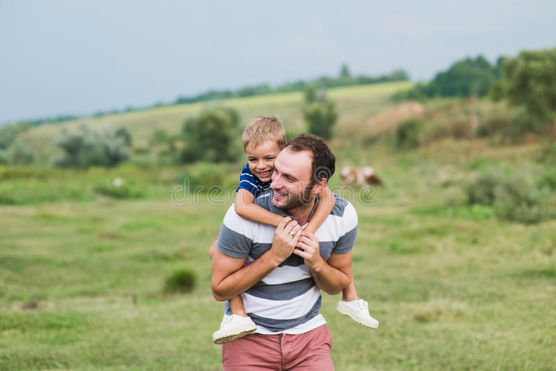 Child sitting on the shoulders of his father. royalty free stock photography