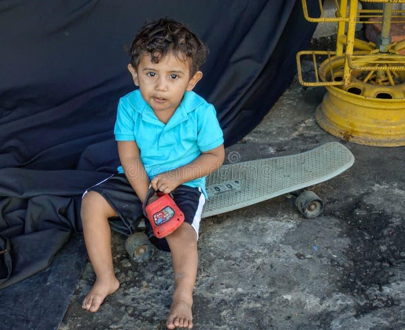 Child Sitting on Skateboard royalty free stock photo