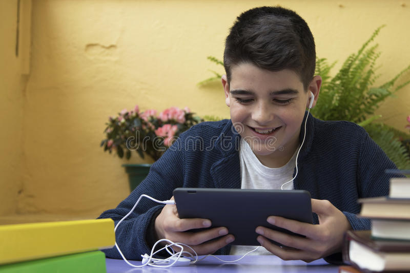 Child sitting with the tablet royalty free stock image