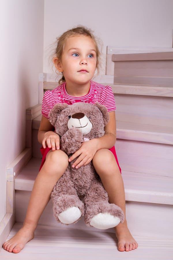 Child sitting toy stairs stock photo