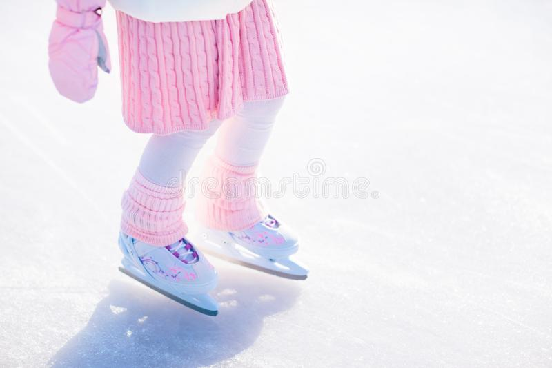 Child skating on natural ice. Kids with skates. stock photos