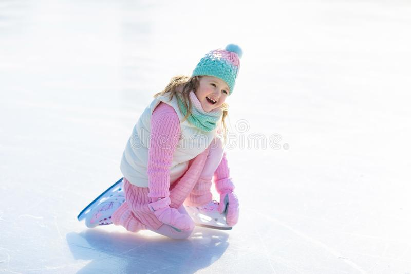 Child skating on natural ice. Kids with skates. royalty free stock photography