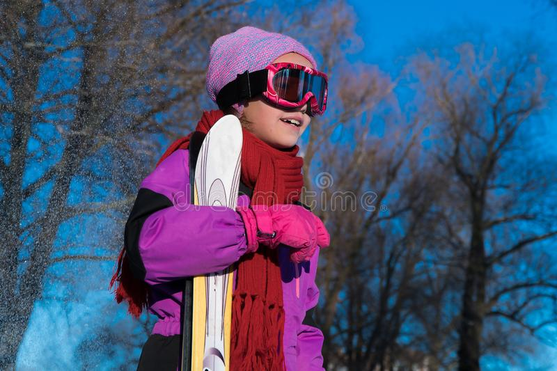 Child ski winter sport. a child learning to ride a ski royalty free stock photography