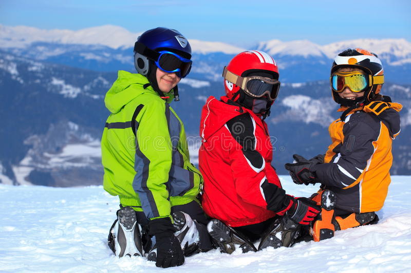 Child skiers on snowy mountain stock images