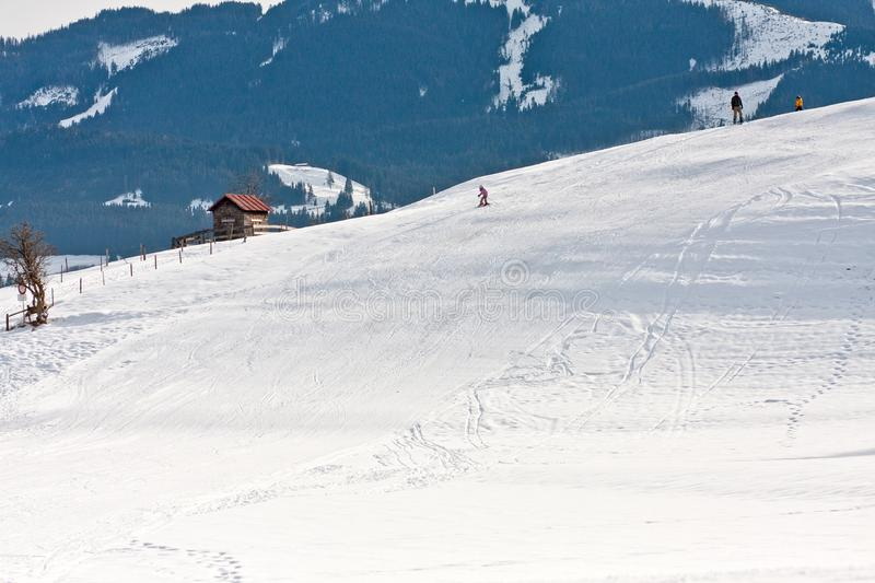 Child skiing down a slope, Bayern, Germany royalty free stock photography