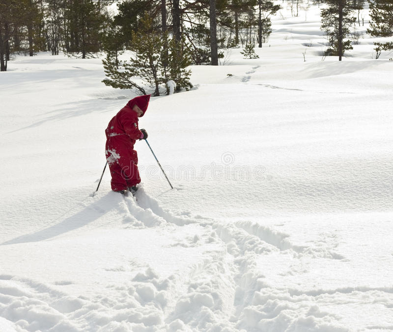 Child skiing off path royalty free stock photography