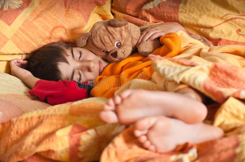 Download Child Sleep In Bed Bare Feet Stock Image - Image: 20093799