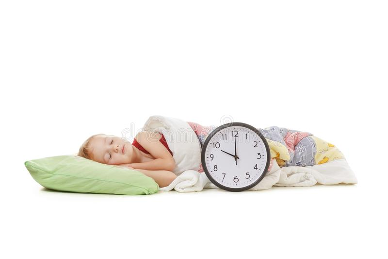 Child sleeping with alarm clock royalty free stock images