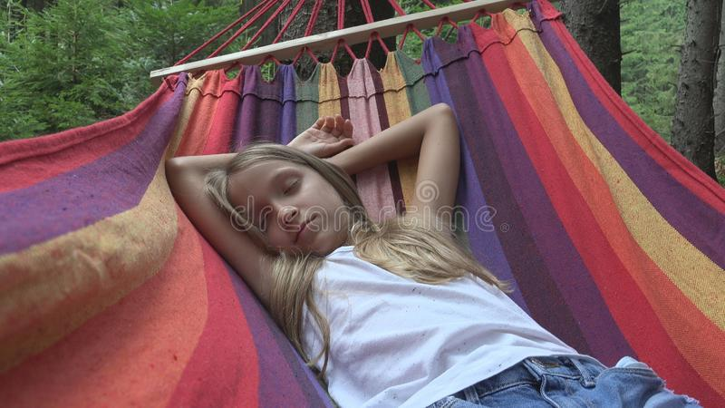 Child Sleeping in Hammock in Camping, Kid Relaxing in Forest, Girl in Mountains.  royalty free stock photography