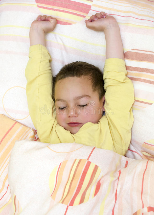 Child sleeping or waking up royalty free stock photo