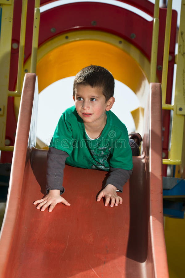 Child on slide stock image