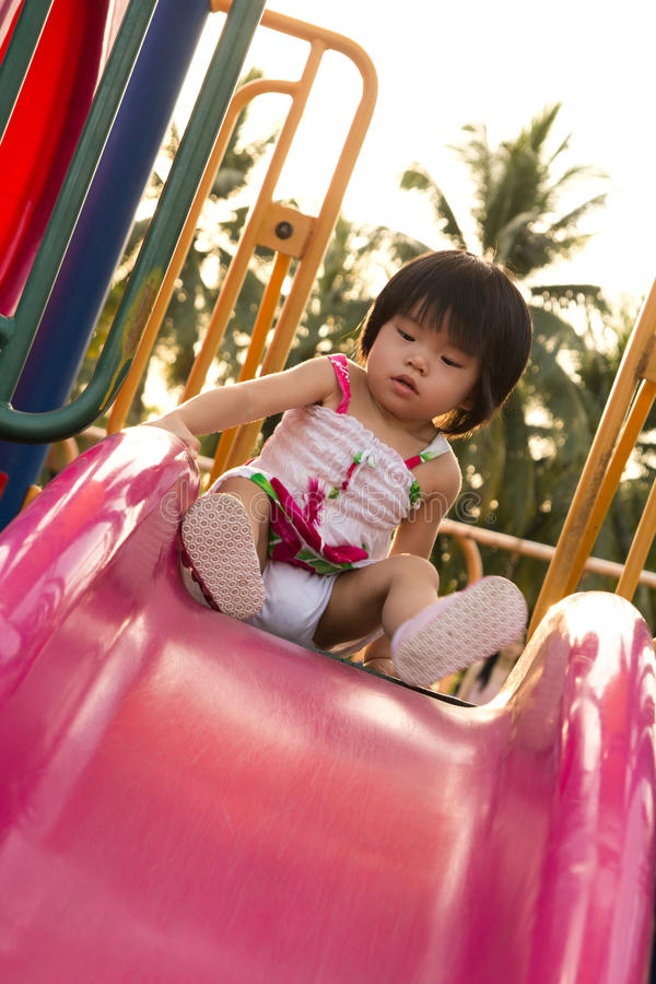 Download Child On A Slide In Playground Stock Photo - Image: 26091922
