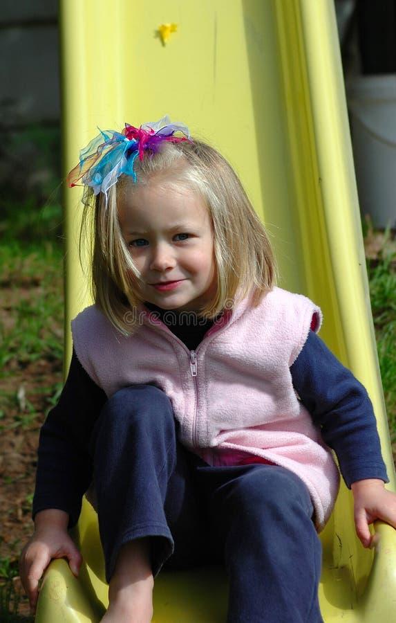 Child sliding stock image