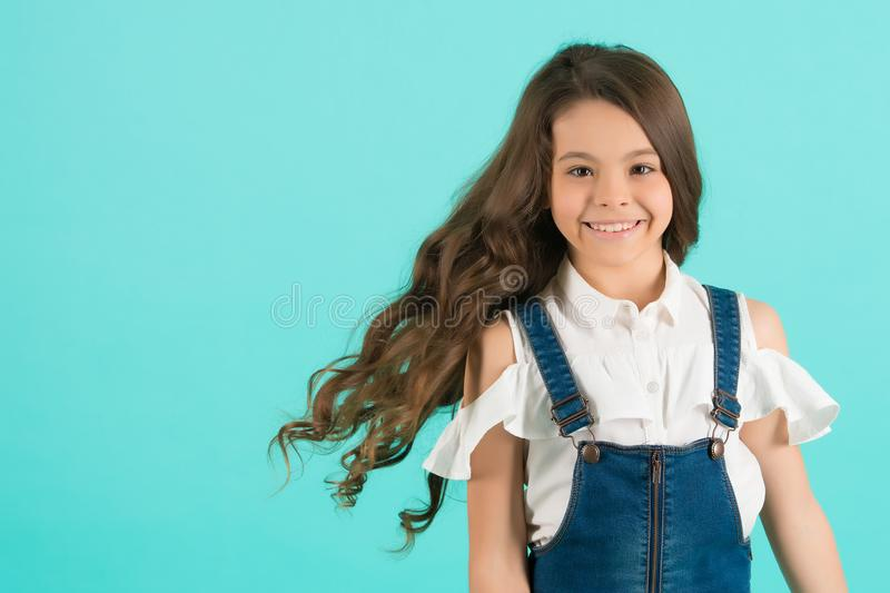 Child smiling with healthy brunette hair royalty free stock photography