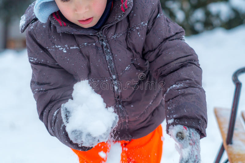 Child with snow stock photo