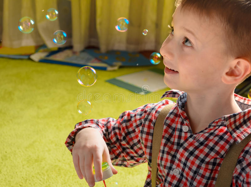 A child and soap bubbles royalty free stock image