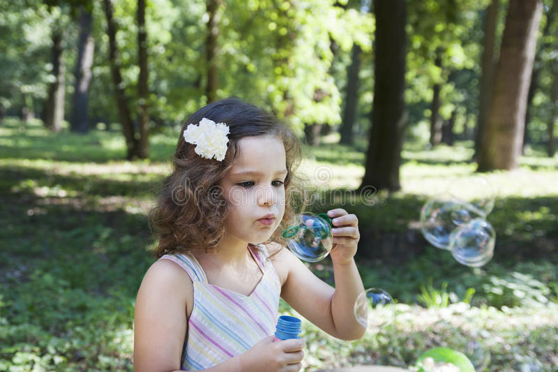 Child and soap bubbles royalty free stock images
