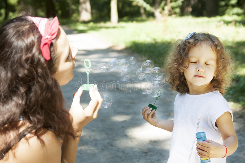 Child and soap bubbles royalty free stock photography
