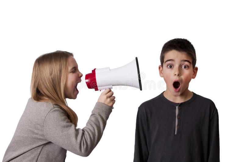 Child with speaker. Girl with megaphone shouting boy with surprised face royalty free stock photos