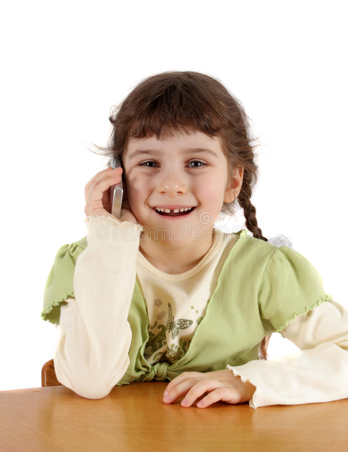 Child speaks by a mobile phone. The child speaks by a mobile phone stock image
