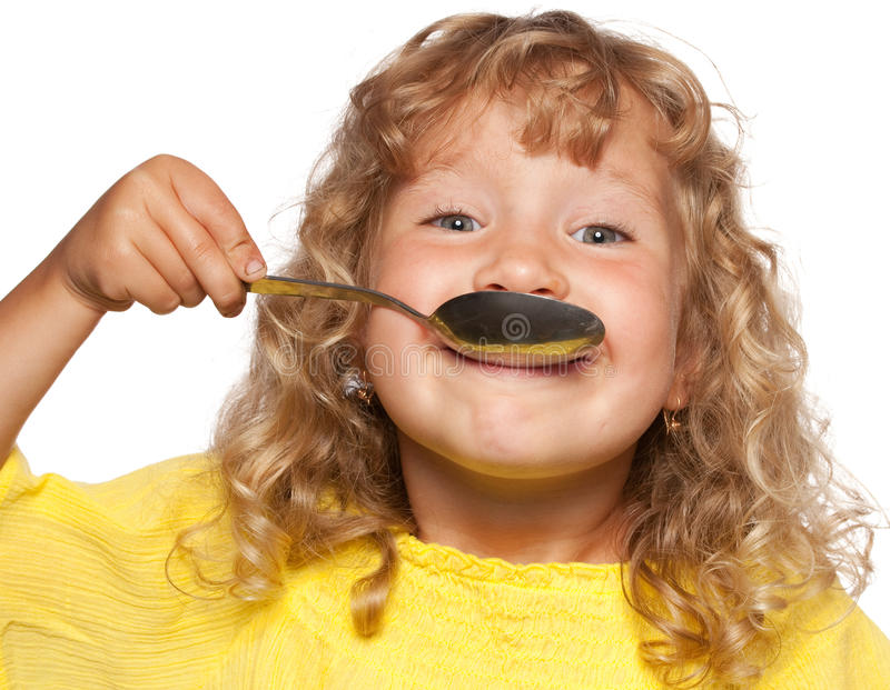 Download Child with spoon stock photo. Image of cute, hands, curly - 20599082
