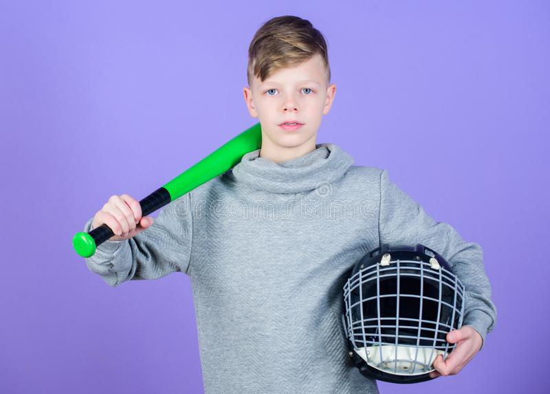 Child sportsman. Sport game. Fitness diet brings health and energy. Gym workout of teen boy. Baseball bat and helmet. Success. Childhood activity. preparing to royalty free stock photo