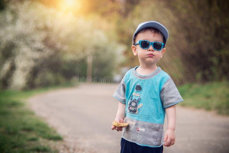 Child in spring park stock photos